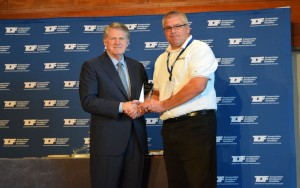 Chris Burns, director of safety and administration, Hardman Construction, (right) accepting Contractor Safety Award with Leo Vecellio, TDF chairman.